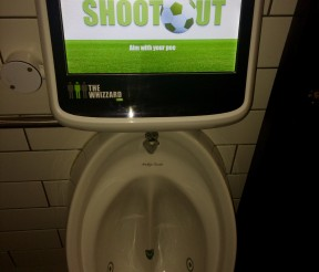 Score penalties with your pee with this urinal football game!
